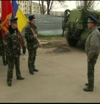Putin: Troops to Bases; Warning Shots in Crimea