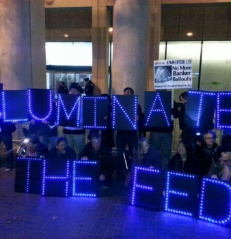Activists around the United States protest the 100th anniversary of the Federal Reserve