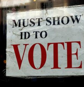 Govt sues Texas over voter ID law